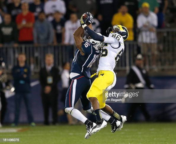 Byron Jones of the Connecticut Huskies intercepts a pass intended for Jehu Chesson of the Michigan Wolverines in the 1st half at Rentschler Field on...