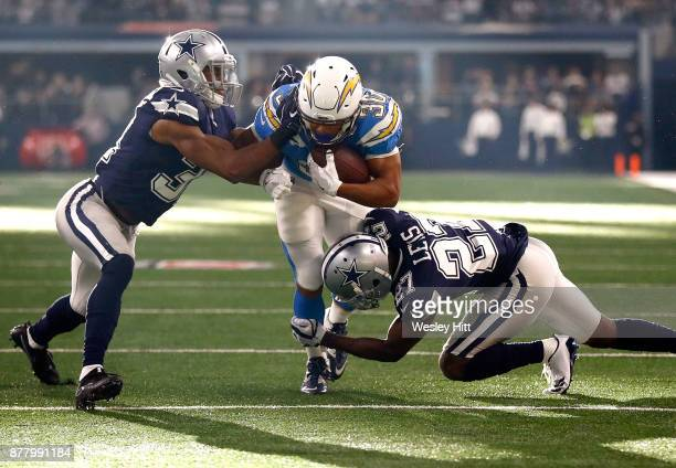 Byron Jones of the Dallas Cowboys and Jourdan Lewis of the Dallas Cowboys combine to tackle Austin Ekeler of the Los Angeles Chargers in the first...