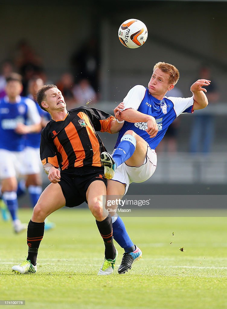 Byron Lawrence of Ipswich Town is tackled by Mark Byrne of Barnet during the pre season friendly match between Barnet and Ipswich Town at The Hive on July 20, 2013 in Barnet, England.