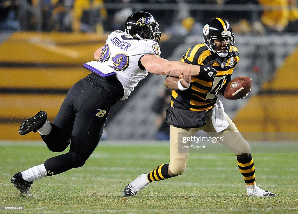 Byron Leftwich #4 of the Pittsburgh Steelers avoids being sacked by Paul Kruger #99 of the Baltimore Ravens on November 18, 2012 at Heinz Field in Pittsburgh, Pennsylvania.