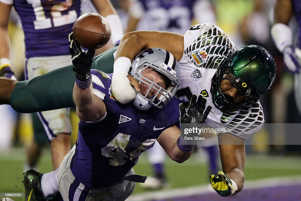 Byron Marshall #9 of the Oregon Ducks tackles Ryan Mueller #44 of the Kansas State Wildcats in the endzone on a blocked extra point attempt that resulted in a safety during the Tostitos Fiesta Bowl at University of Phoenix Stadium on January 3, 2013 in Glendale, Arizona.