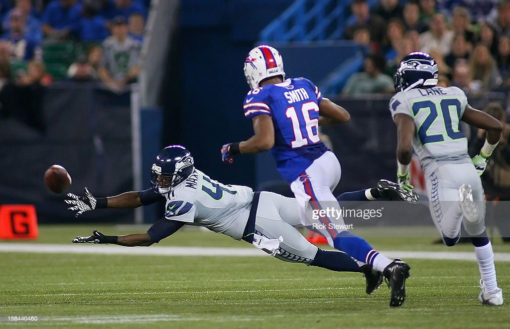 Byron Maxwell #41 of the Seattle Seahawks can't reach a pass for an interception against the Buffalo Bills at Rogers Centre on December 16, 2012 in Toronto, Ontario, Canada. Seattle won 50-17.