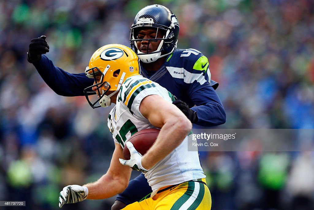 Byron Maxwell of the Seattle Seahawks ctackles Jordy Nelson of the Green Bay Packers during the third quarter of the 2015 NFC Championship game at...