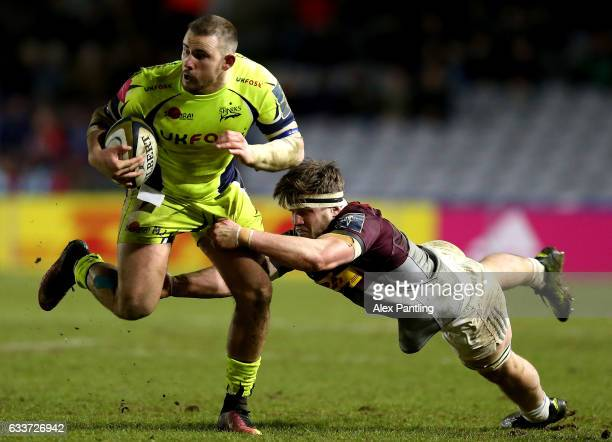 Byron McGuigan of Sale Sharks is tackled by Jack Clifford of Harlequins during the AngloWelsh Cup match between Harlequins and Sale Sharks at...