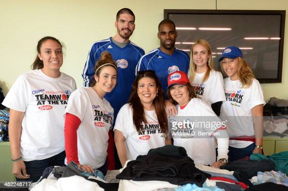 Byron Mullens and Antawn Jamison pose with volunteers during the Teamwork at the Table Thanksgiving Event at the St Joseph Center on November 26 2013...