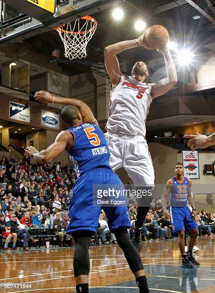 Byron Mullens from the Sioux Falls Skyforce takes the ball to the basket against Darion Atkins from the Westchester Knicks at the Sanford Pentagon on...