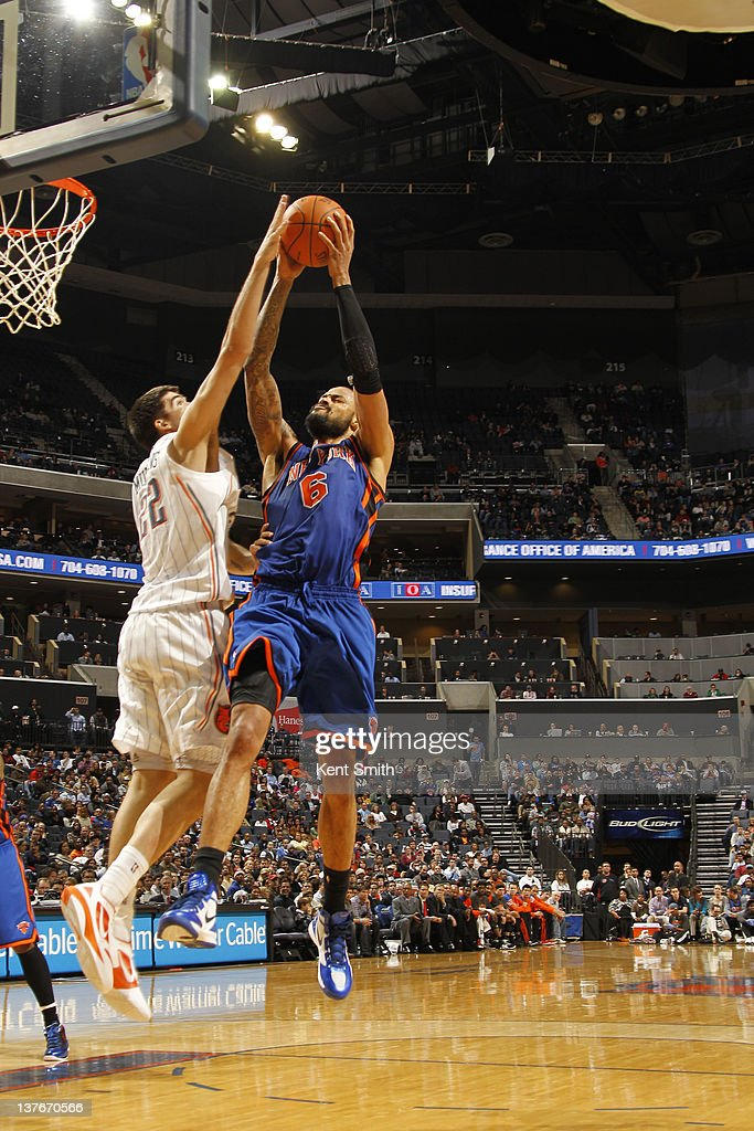 Byron Mullens #22 of the Charlotte Bobcats blocks against <a gi-track='captionPersonalityLinkClicked' href=/galleries/search?phrase=Tyson+Chandler&family=editorial&specificpeople=202061 ng-click='$event.stopPropagation()'>Tyson Chandler</a> #6 of the New York Knicks during the game at the Time Warner Cable Arena on January 24, 2012 in Charlotte, North Carolina.