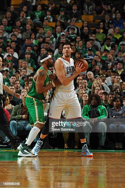 Byron Mullens of the Charlotte Bobcats controls the ball against Chris Wilcox of the Boston Celtics on March 16 2013 at the TD Garden in Boston...