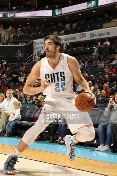 Byron Mullens of the Charlotte Bobcats dribbles the ball looking to shoot against the Washington Wizards at the Time Warner Cable Arena on March 18...