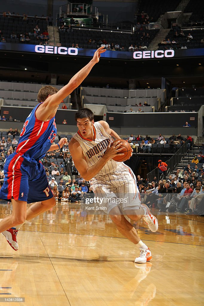 Byron Mullens #22 of the Charlotte Bobcats drives against <a gi-track='captionPersonalityLinkClicked' href=/galleries/search?phrase=Jonas+Jerebko&family=editorial&specificpeople=5942357 ng-click='$event.stopPropagation()'>Jonas Jerebko</a> #33 of the Detroit Pistons at the Time Warner Cable Arena on April 12, 2012 in Charlotte, North Carolina.
