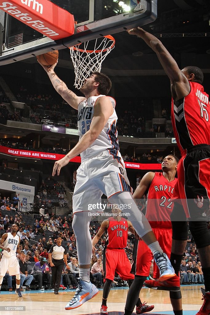 Byron Mullens #22 of the Charlotte Bobcats drives to the basket against the Toronto Raptors at the Time Warner Cable Arena on March 20, 2013 in Charlotte, North Carolina.