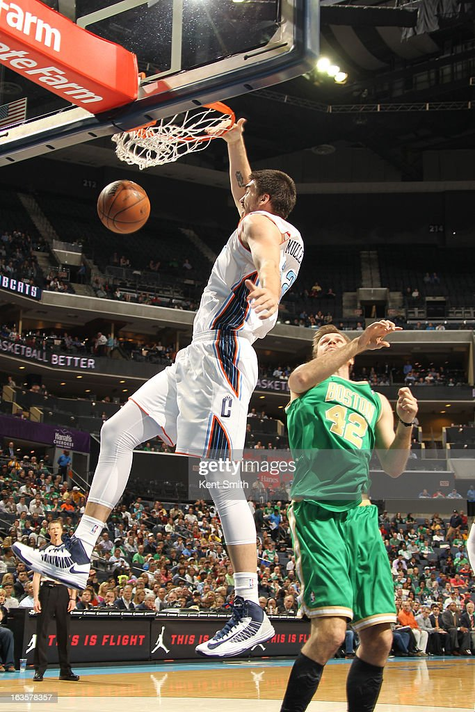 Byron Mullens #22 of the Charlotte Bobcats dunks against Shavlik Randolph #42 of the Boston Celtics at the Time Warner Cable Arena on March 12, 2013 in Charlotte, North Carolina.