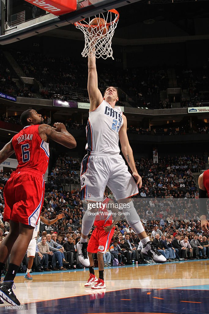 Byron Mullens #22 of the Charlotte Bobcats dunks against the Los Angeles Clippers at the Time Warner Cable Arena on December 12, 2012 in Charlotte, North Carolina.