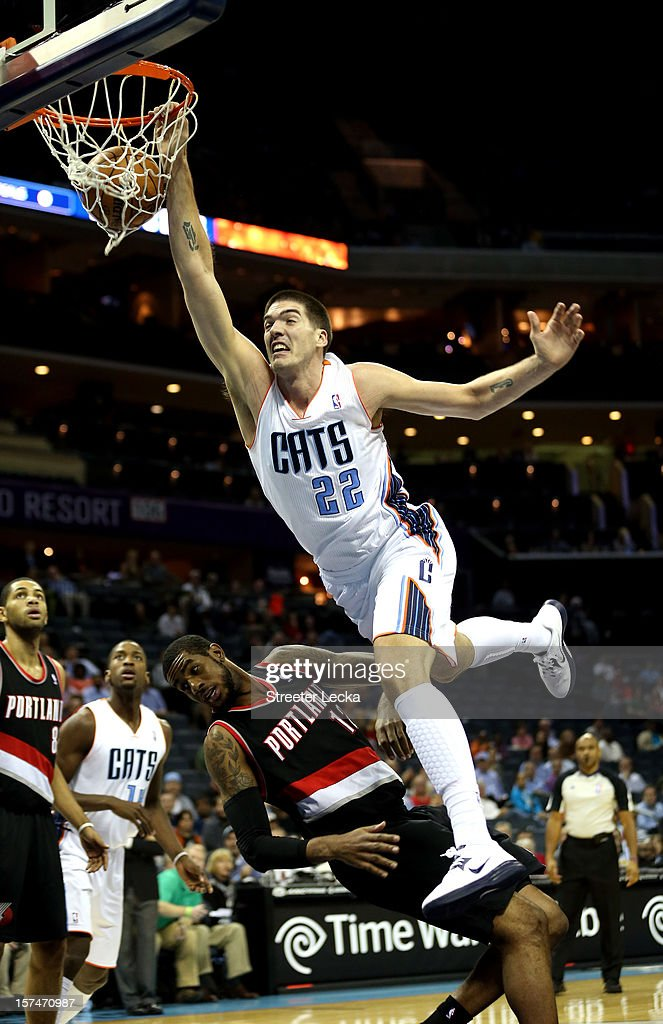 Byron Mullens #22 of the Charlotte Bobcats dunks on LaMarcus Aldridge #12 of the Portland Trail Blazers during their game at Time Warner Cable Arena on December 3, 2012 in Charlotte, North Carolina.
