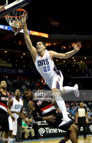 Byron Mullens of the Charlotte Bobcats dunks on LaMarcus Aldridge of the Portland Trail Blazers during their game at Time Warner Cable Arena on...