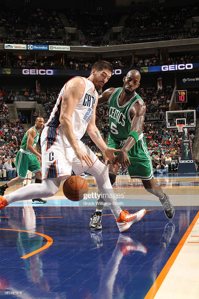 Byron Mullens #22 of the Charlotte Bobcats keeps control of the ball against Kevin Garnett #5 of the Boston Celtics at the Time Warner Cable Arena on February 11, 2013 in Charlotte, North Carolina.