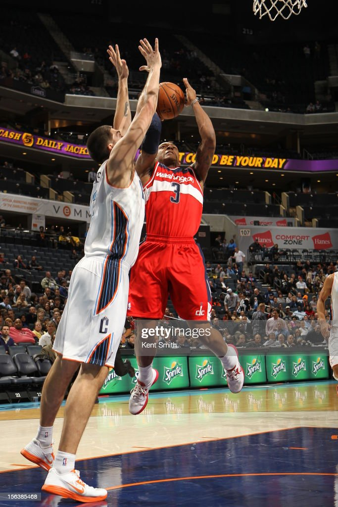 Byron Mullens #22 of the Charlotte Bobcats on the block against <a gi-track='captionPersonalityLinkClicked' href=/galleries/search?phrase=Bradley+Beal&family=editorial&specificpeople=7640439 ng-click='$event.stopPropagation()'>Bradley Beal</a> #3 of the Washington Wizards at the Time Warner Cable Arena on November 13, 2012 in Charlotte, North Carolina.