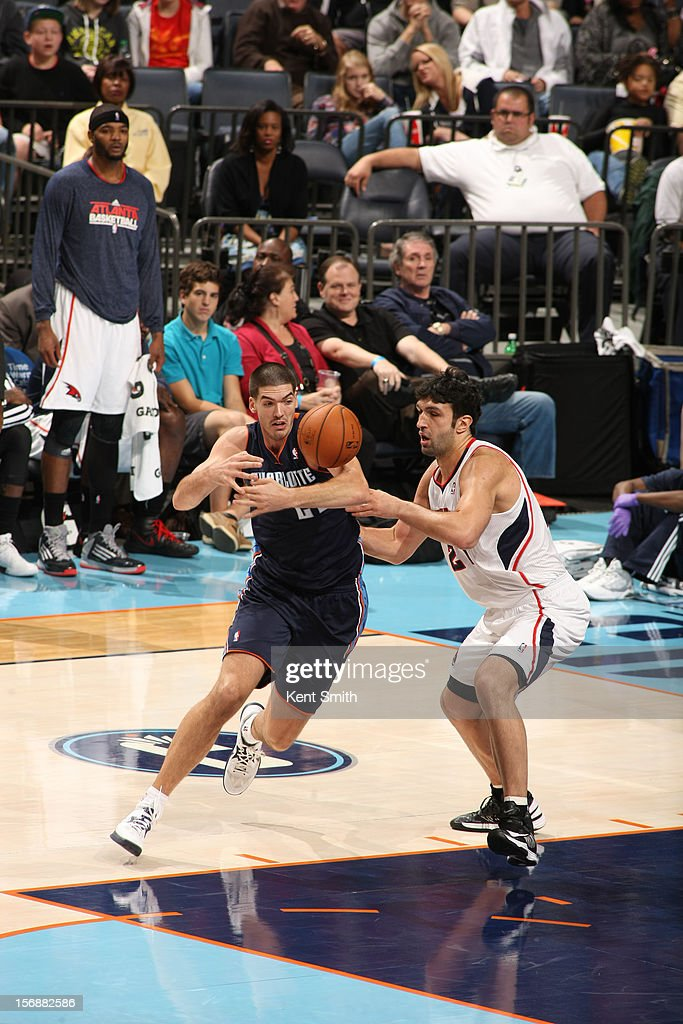 Byron Mullens #22 of the Charlotte Bobcats on the grab against <a gi-track='captionPersonalityLinkClicked' href=/galleries/search?phrase=Zaza+Pachulia&family=editorial&specificpeople=202939 ng-click='$event.stopPropagation()'>Zaza Pachulia</a> #27 of the Atlanta Hawks at the Time Warner Cable Arena on November 23, 2012 in Charlotte, North Carolina.