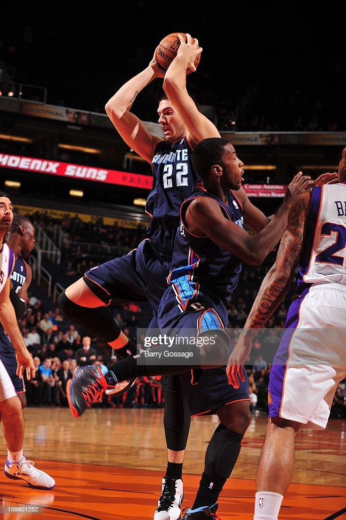 Byron Mullens #22 of the Charlotte Bobcats pulls down a rebound against the Phoenix Suns on December 19, 2012 at U.S. Airways Center in Phoenix, Arizona.