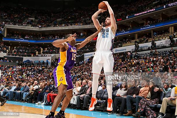 Byron Mullens of the Charlotte Bobcats shoots a threepointer against Metta World Peace of the Los Angeles Lakers at Time Warner Cable Arena on...