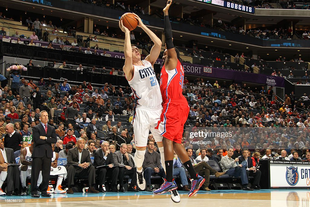 Byron Mullens #22 of the Charlotte Bobcats shoots against Ronny Turiaf #21 of the Los Angeles Clippers at the Time Warner Cable Arena on December 12, 2012 in Charlotte, North Carolina.