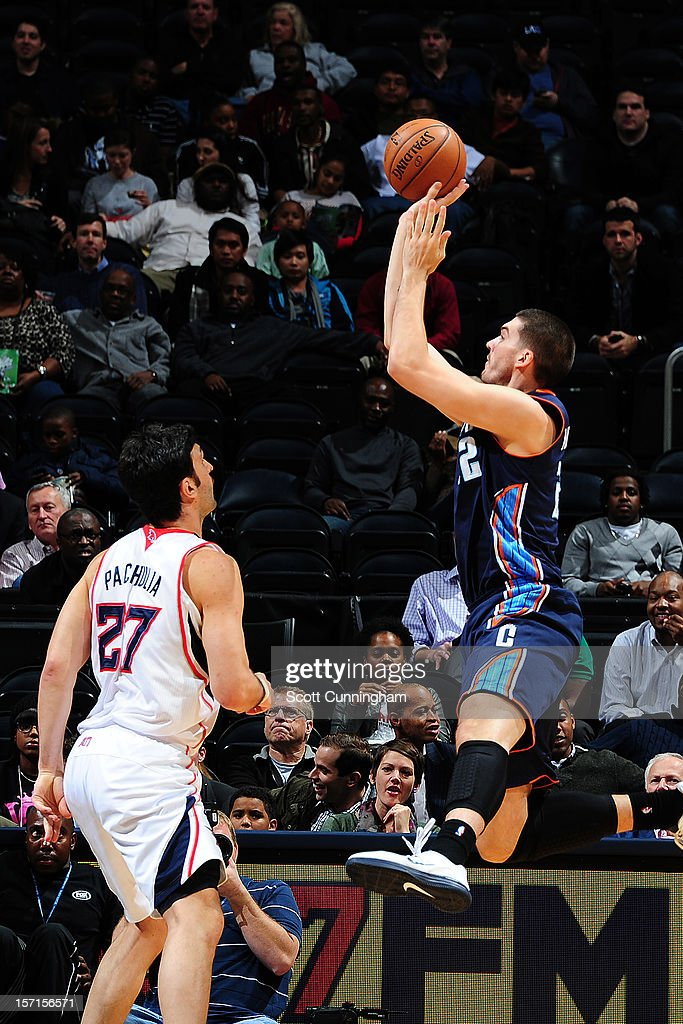 Byron Mullens #22 of the Charlotte Bobcats shoots against <a gi-track='captionPersonalityLinkClicked' href=/galleries/search?phrase=Zaza+Pachulia&family=editorial&specificpeople=202939 ng-click='$event.stopPropagation()'>Zaza Pachulia</a> #27 of the Atlanta Hawks at Philips Arena on November 28, 2012 in Atlanta, Georgia.