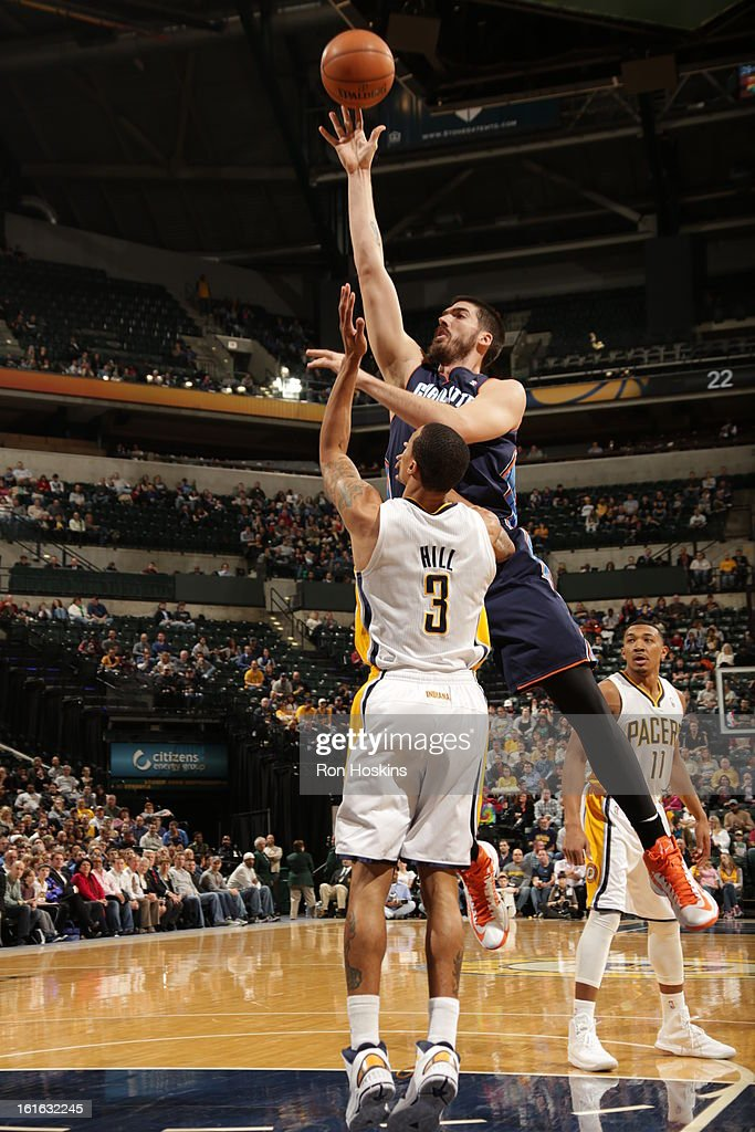 Byron Mullens #22 of the Charlotte Bobcats shoots over George Hill #3 of the Indiana Pacers on February 13, 2013 at Bankers Life Fieldhouse in Indianapolis, Indiana.