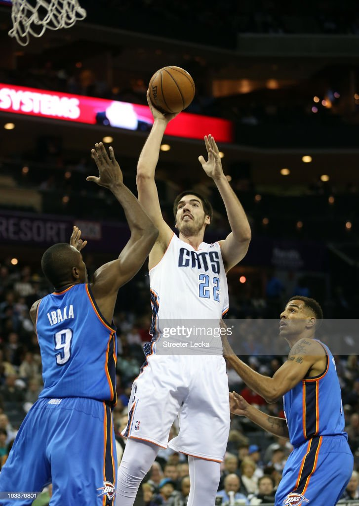Byron Mullens #22 of the Charlotte Bobcats shoots over Serge Ibaka #9 of the Oklahoma City Thunder during their game at Time Warner Cable Arena on March 8, 2013 in Charlotte, North Carolina.