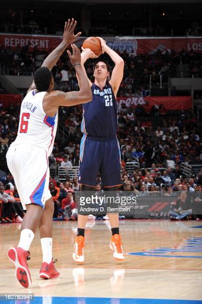 Byron Mullens of the Charlotte Bobcats takes a shot against DeAndre Jordan of the Los Angeles Clippers at Staples Center on February 26 2013 in Los...