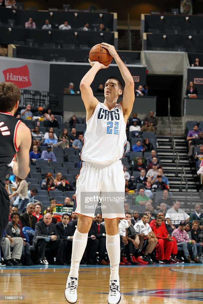 Byron Mullens #22 of the Charlotte Bobcats takes a shot against the Portland Trail Blazers at the Time Warner Cable Arena on December 3, 2012 in Charlotte, North Carolina.