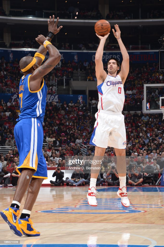 Byron Mullens of the Los Angeles Clippers attempts a shot against Jermaine O'Neal of the Golden State Warriors at STAPLES Center on October 31 2013...