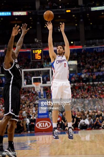Byron Mullens of the Los Angeles Clippers attempts a shot during a game against the Brooklyn Nets on November 16 2013 at STAPLES Center in Los...