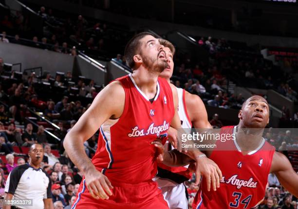Byron Mullens of the Los Angeles Clippers awaits a rebound against the Portland Trail Blazers on October 7 2013 at the Moda Center Arena in Portland...