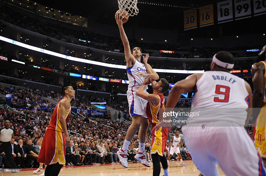 Byron Mullens of the Los Angeles Clippers goes up for a shot against against the Houston Rockets at Staples Center on November 4 2013 in Los Angeles...