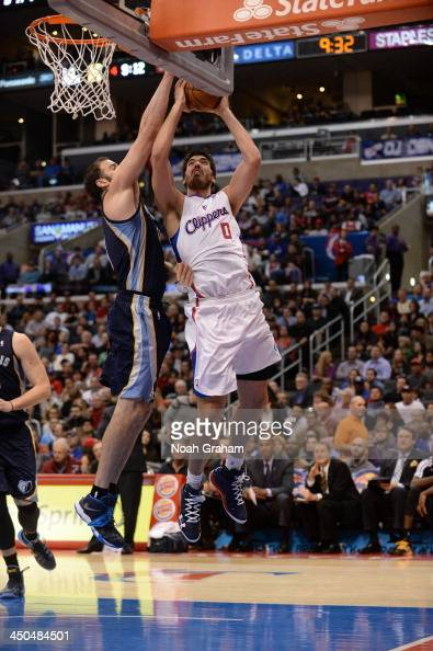 Byron Mullens of the Los Angeles Clippers shoots against Kosta Koufos of the Memphis Grizzlies at Staples Center on November 18 2013 in Los Angeles...