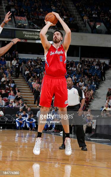 Byron Mullens of the Los Angeles Clippers shoots against the Sacramento Kings on October 14 2013 at Sleep Train Arena in Sacramento California NOTE...
