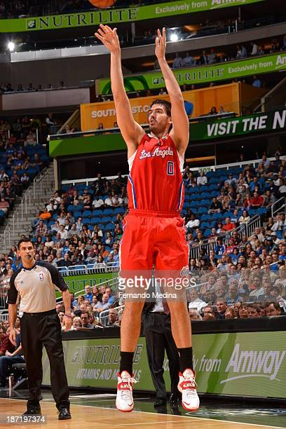 Byron Mullens of the Los Angeles Clippers shoots the ball against the Orlando Magic during the game on November 6 2013 at Amway Center in Orlando...