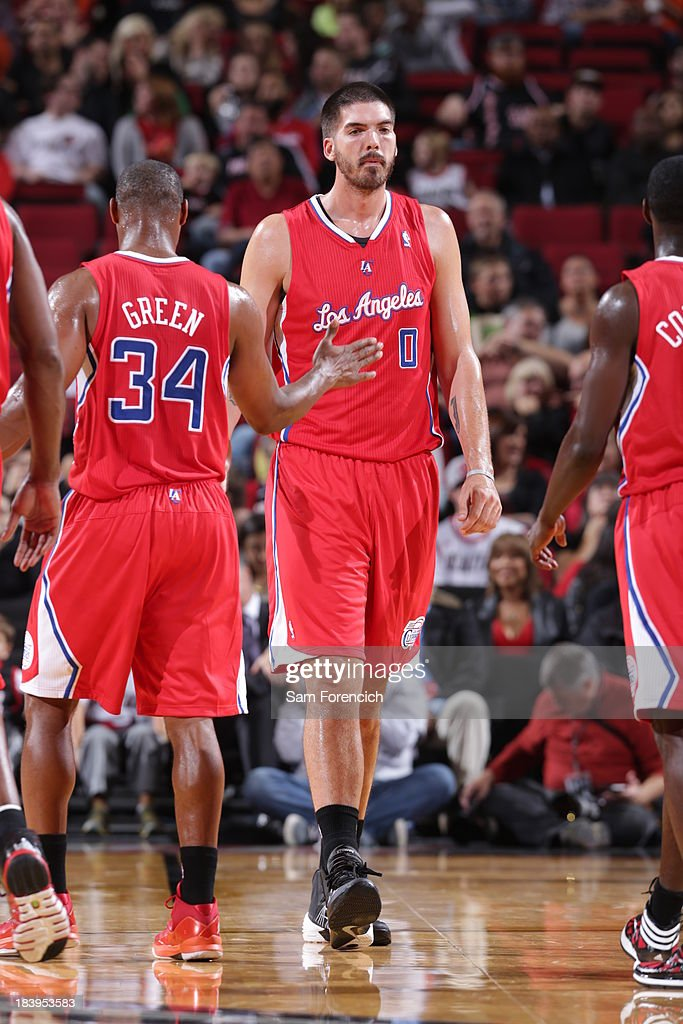 Byron Mullens of the Los Angeles Clippers walks up court against the Portland Trail Blazers on October 7 2013 at the Moda Center Arena in Portland...