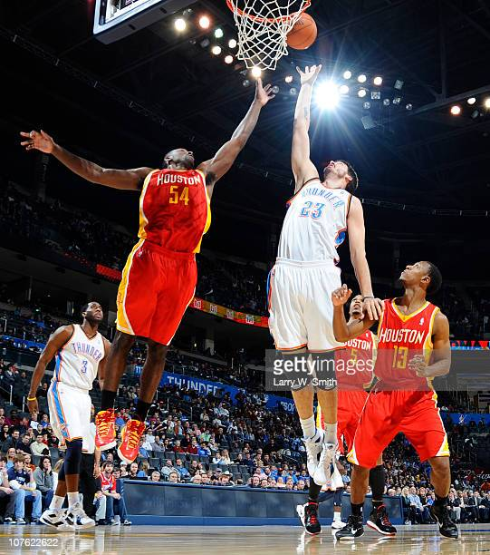 Byron Mullens of the Oklahoma City Thunder goes for a rebound against Patrick Patterson of the Houston Rockets during the game at the Oklahoma City...