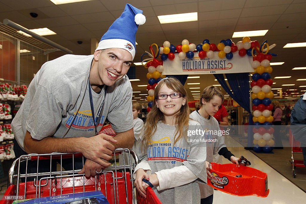 Byron Mullens of the Oklahoma City Thunder shops for toys during a holiday shopping spree with ten families from the Grandparents Raising Grandchildren program on Tuesday, Dec. 13 at a Target store in northwest Oklahoma City in Oklahoma City, Oklahoma.