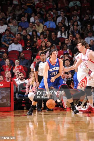 Byron Mullens of the Philadelphia 76ers drives against Omer Asik of the Houston Rockets on March 27 2014 at the Toyota Center in Houston Texas NOTE...