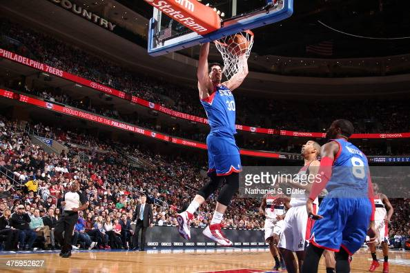Byron Mullens of the Philadelphia 76ers dunks during a game against the Washington Wizards at Wells Fargo Center in Philadelphia PA on March 1 2014...