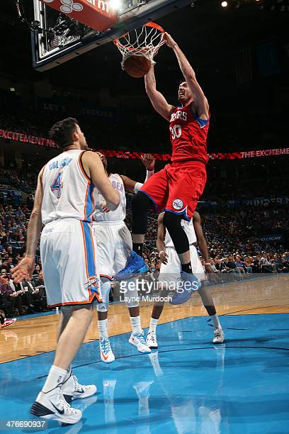 Byron Mullens of the Philadelphia 76ers dunks the ball against the Oklahoma City Thunder during an NBA game on March 4 2014 at the Chesapeake Energy...