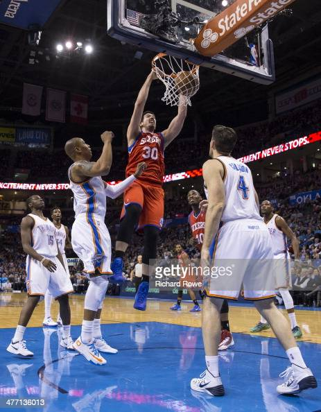 Byron Mullens of the Philadelphia 76ers dunks the ball against the Oklahoma City Thunder at the Chesapeake Arena on March 4 2014 in Oklahoma City...