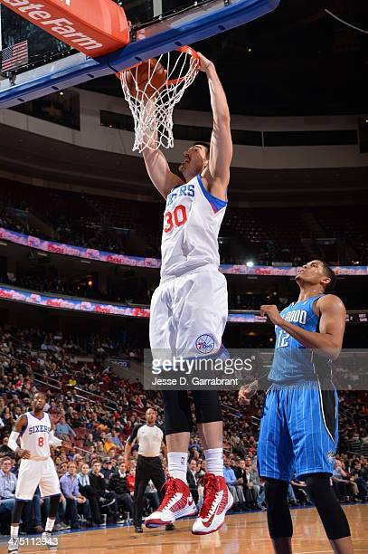 Byron Mullens of the Philadelphia 76ers goes up for the dunk against of the Orlando Magic at the Wells Fargo Center on February 26 2014 in...