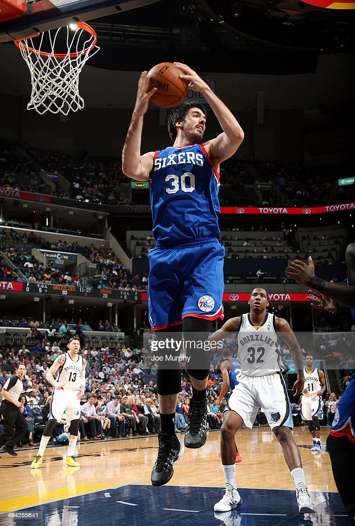 Byron Mullens of the Philadelphia 76ers grabs a rebound against the Memphis Grizzlies on April 11 2014 at FedExForum in Memphis Tennessee NOTE TO...