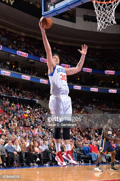 Byron Mullens of the Philadelphia 76ers rebounds the ball against the Indiana Pacers at the Wells Fargo Center on March 14 2014 in Philadelphia...