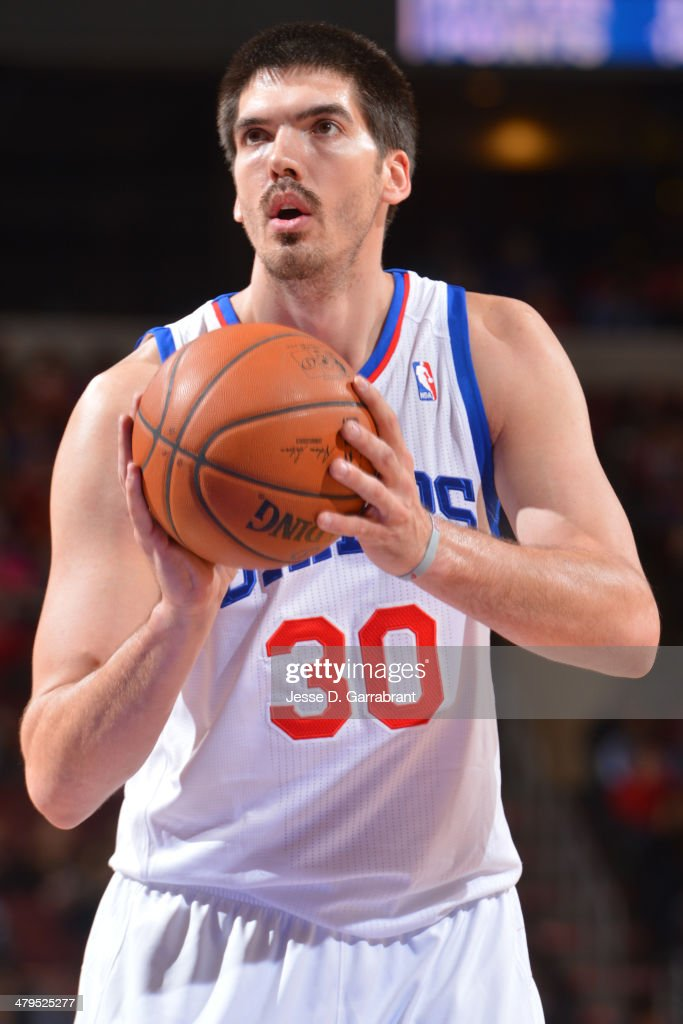 Byron Mullens of the Philadelphia 76ers shoots a free throw against the Orlando Magic at the Wells Fargo Center on February 26 2014 in Philadelphia...
