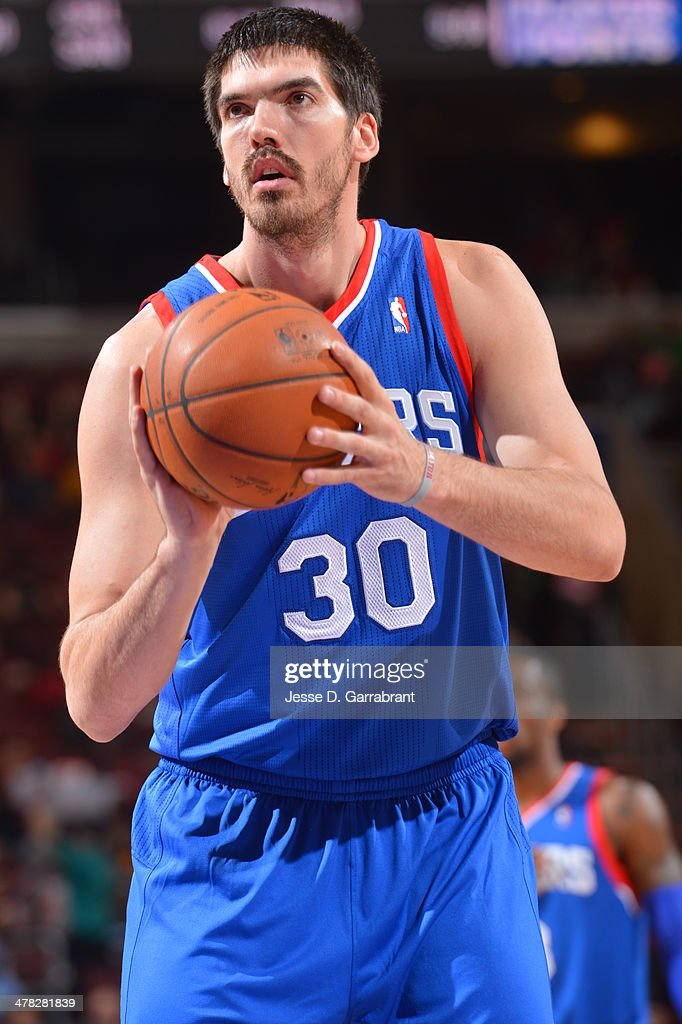 Byron Mullens of the Philadelphia 76ers shoots a free throw during the game against the Utah Jazz at the Wells Fargo Center on March 8 2014 in...