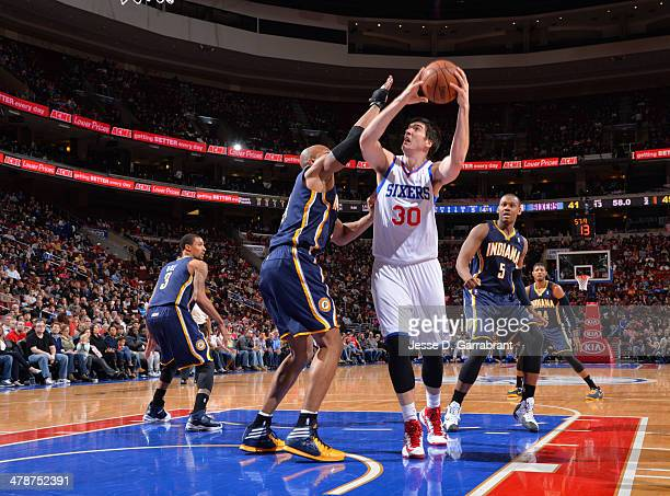 Byron Mullens of the Philadelphia 76ers shoots against the Indiana Pacers at the Wells Fargo Center on March 14 2014 in Philadelphia Pennsylvania...